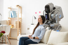 Modern robot making a massage Stock Image