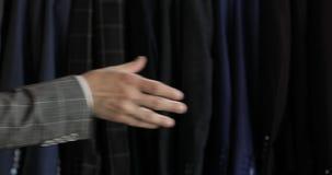 Modern Robotic Technologies. A man communicates with a robot, handshake. stock video