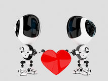 Modern robots hold love symbol Royalty Free Stock Photos