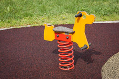 Modern rocking horse. In a city park playground Stock Photos