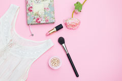 Modern romance. Clothing and accessories on a pink background Royalty Free Stock Photos