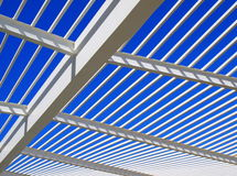 Modern roof architecture. With white steel and blue sky in the background Royalty Free Stock Image