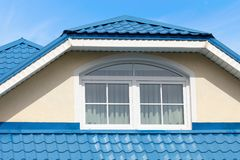 Modern roof blue metal roofing and skylight. On a Sunny summer day stock photos