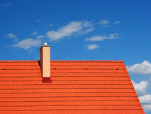 Modern roof with chimney Stock Photo