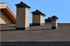 Modern roofing and decoration of chimneys. Flexible bitumen or slate shingles. The absence of corrosion and condensation due to t. He flexible roof stock photo