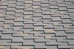 Modern roofing and decoration of chimneys. Flexible bitumen or slate shingles. In rectangular shape in perspective stock images
