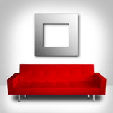 Modern room. Modern red couch and silver frame in a white room Stock Photography