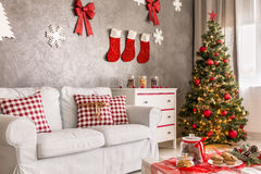 Modern room with christmas tree Royalty Free Stock Photos