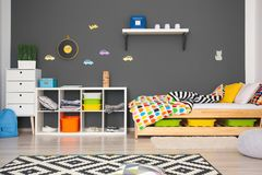 Modern room interior with comfortable bed. For child Stock Photography