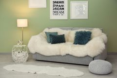 Modern room interior with sofa. Modern room interior with cozy sofa Stock Photography