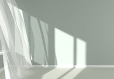 Modern  Room Interior with white curtains and sunlight. Empty room with sunlight shining through a window and the curtains developed by a wind Stock Photos