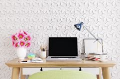 Modern room with  laptop computer on a desk,  home office workspace Royalty Free Stock Photography
