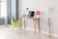 Modern room with  laptop computer on a desk,  home office workspace Royalty Free Stock Image