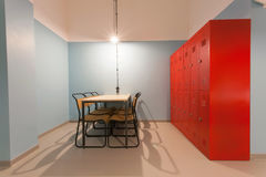 Modern room looks like prison with table and iron locker in a hostel for students Stock Photo