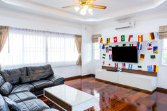 Modern room with TV and Flags Royalty Free Stock Image