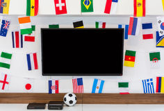 Modern room with TV and Flags for soccer championship 2014 Royalty Free Stock Image