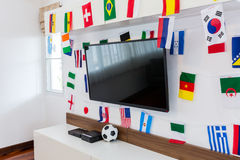 Modern room with TV and Flags for soccer championship 2014 Stock Images