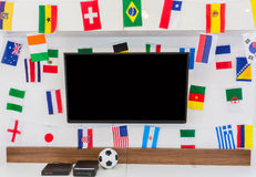 Modern room with TV and Flags for soccer championship 2014 Royalty Free Stock Images