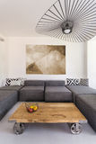 Modern room with wooden coffee table Royalty Free Stock Images