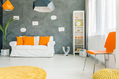 Modern room with yellow clock. Modern and spacious  room with small yellow clock Royalty Free Stock Images