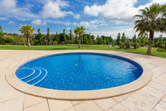 Modern round pool. In the tropics, near the hotel. stock photos