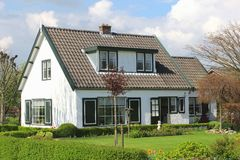 Modern rural house with garden in Holland Stock Images