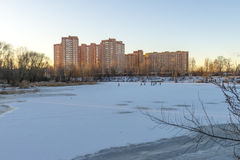 Modern Russian city on the shore of a pond in winter Royalty Free Stock Images
