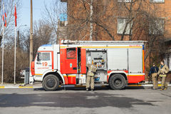 Modern Russian fire engine with firefighters Royalty Free Stock Photo