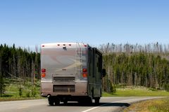 Modern RV recreational vehicle. A large and modern RV / Recreational Vehicle driving through yellowstone national park, wyoming Royalty Free Stock Images