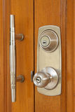 The modern and safe lock on  wooden door. The modern and safe lock on a wooden door Stock Photography