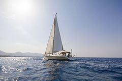 Modern sailing boat at the Aegean sea. View of a modern sailing boat cruising the Aegean sea, Greece Royalty Free Stock Photos