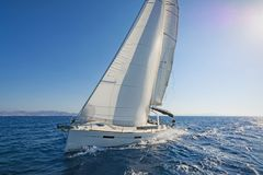 Modern sailing yacht in action. View of a modern sailing yacht in action. Blue waters of the Aegean sea, Greece stock photo