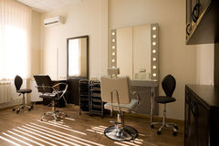 Modern salon make-up artist and hairdresser. Royalty Free Stock Image