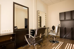 Modern salon make-up artist and hairdresser. Stock Photography