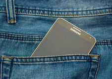 Modern SAMSUNG GALAXY NOTE in a denim pocket Royalty Free Stock Images
