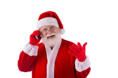 Modern Santa. Happy Santa talking on his smartphone Royalty Free Stock Photos