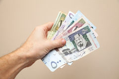 Modern Saudi Arabia money, banknotes in male hand Stock Photos