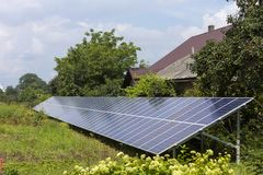 Free Modern Saving Efficient Stand -alone Blue Shiny Solar Photo Voltaic Panels System Producing Renewable Clean Green Energy In Green Stock Image - 124064371