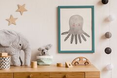 The modern scandinavian newborn baby room with mock up frame, plush toys, children accessories, stars and hanging balls..