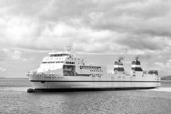Modern schip in blauwe overzees stock foto's