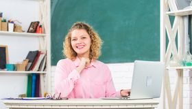 Modern school. Teachers day. Woman work online. Distance teaching. Teachers forum. Educator surfing internet. Communication social networks. Intelligent girl royalty free stock images