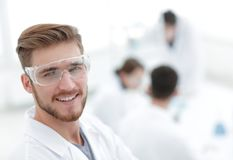 Modern scientist on laboratory background. Photo with copy space Stock Photos