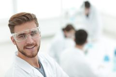 Modern scientist on laboratory background. Photo with copy space Royalty Free Stock Photography