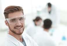 Modern scientist on laboratory background. Photo with copy space Stock Images