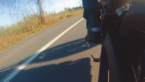 Modern scrambler motorbike on the forest road riding. having fun driving the empty road stock video footage