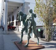 Modern sculpture of Adam and Eve, Ljubljana. Modern sculpture of Adam and Eve, ashamed and banished from Paradise, made by contemporary Slovene sculptor Jakov Stock Image