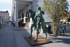 Modern sculpture of Adam and Eve, Ljubljana. Modern sculpture of Adam and Eve, ashamed and banished from Paradise, made by contemporary Slovene sculptor Jakov Stock Photos