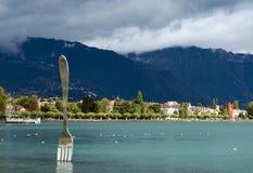 Modern sculpture - big fork in water of Geneva lake Royalty Free Stock Photography