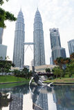 Modern sculpture in KLCC Park and Petronas Twin Towers, Kuala Lumpur Stock Photo