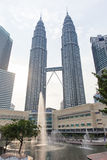 Modern sculpture in KLCC Park and Petronas Twin Towers, Kuala Lumpur Royalty Free Stock Image